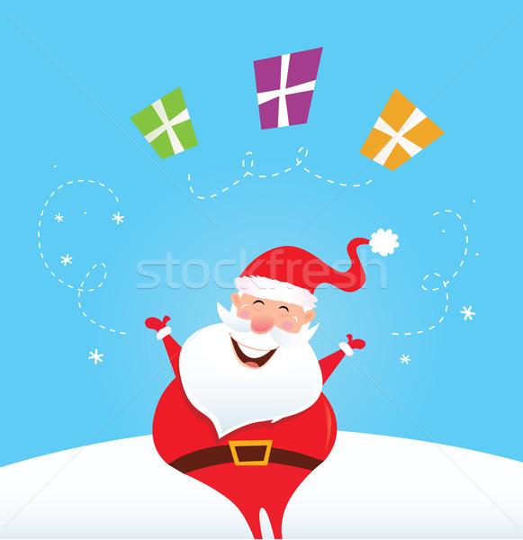 Happy Santa Claus juggling christmas presents Stock photo © lordalea