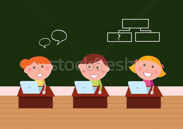 Children & school: Cute happy kids in classroom using Laptop