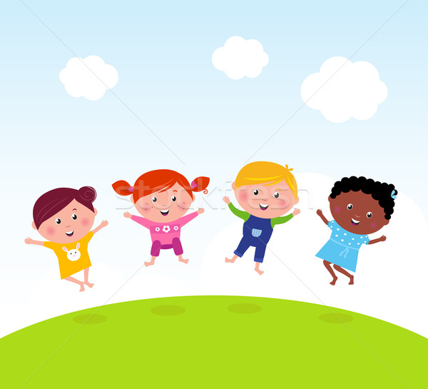 Happy group of multicultural kids jumping on summer meadow