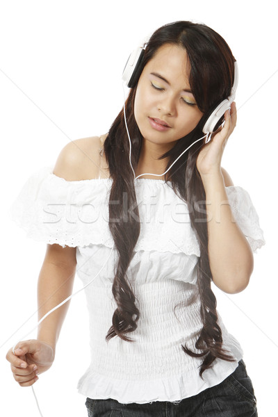 女性 音楽を聴く 若い女性 着用 ヘッドホン 白 ストックフォト © lorenzodelacosta