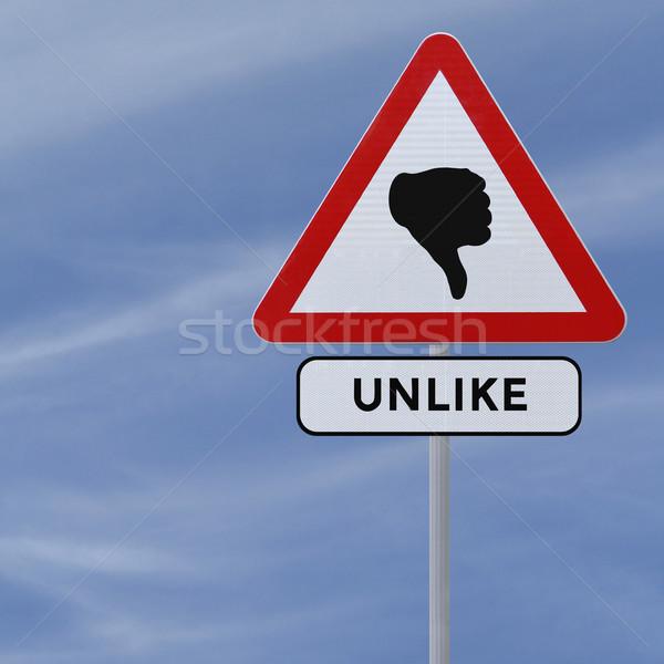 Unlike Road Sign  Stock photo © lorenzodelacosta