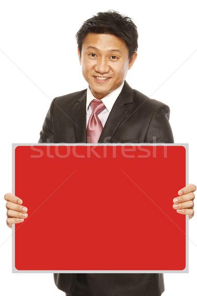Empresário mensagem homem traje de negócios vermelho Foto stock © lorenzodelacosta