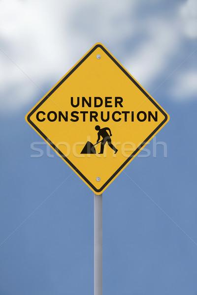 építkezés felirat puha kék ég férfiak háló Stock fotó © lorenzodelacosta