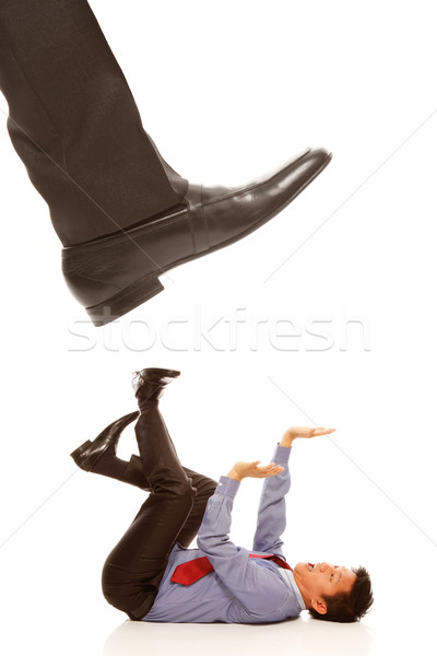 Businessman About To Be Stepped On  Stock photo © lorenzodelacosta