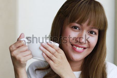 Stock photo: Young Woman Drinking Coffee