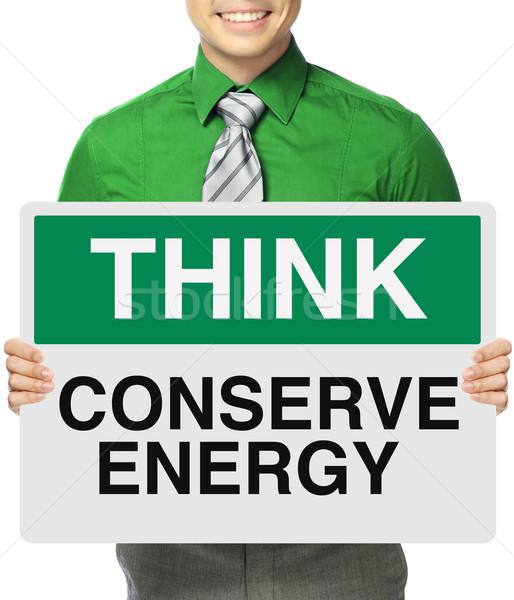 Enerji adam enerji tasarrufu imzalamak düşünmek Stok fotoğraf © lorenzodelacosta