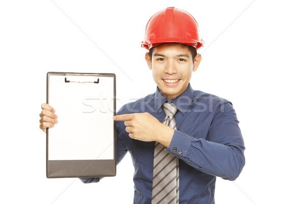 Férfi visel munkavédelmi sisak védősisak mutat üres Stock fotó © lorenzodelacosta