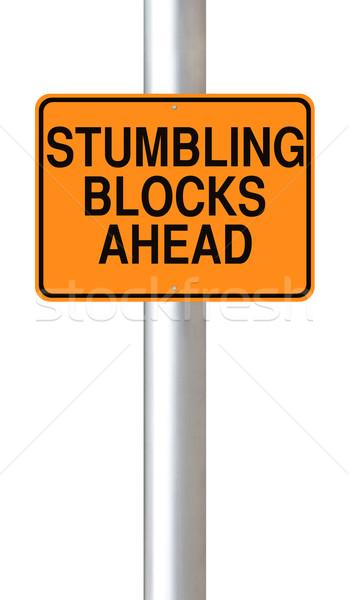 Foto stock: Blocos · à · frente · placa · sinalizadora · aviso · laranja · fundo · branco