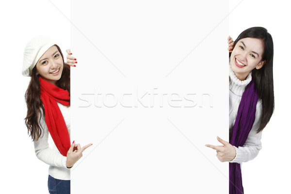 Young Women Pointing At Blank Space  Stock photo © lorenzodelacosta