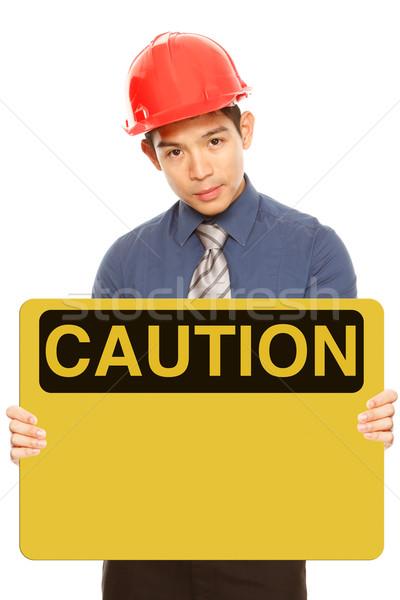 Vigyázat felirat férfi visel munkavédelmi sisak tart Stock fotó © lorenzodelacosta