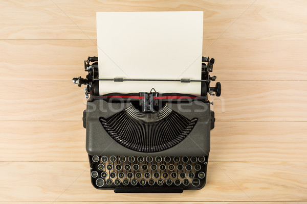 vintage typewriter isolated on wooden background Stock photo © lostation