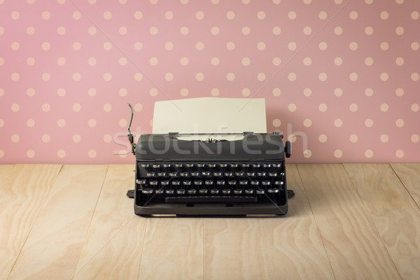 Image of vintage typewriter on pink polka dots wallpaper Stock photo © lostation