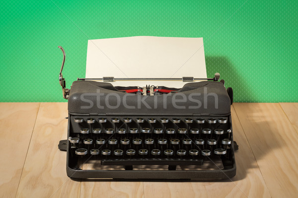 Image of vintage typewriter on green wallpaper Stock photo © lostation