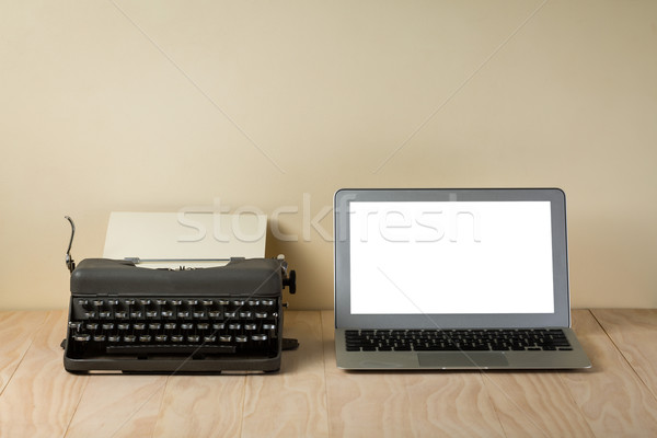 Image of vintage typewriter and modern laptop Stock photo © lostation