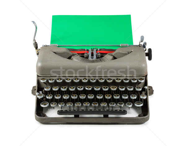 Vintage typewriter with green paper isolated on white background Stock photo © lostation