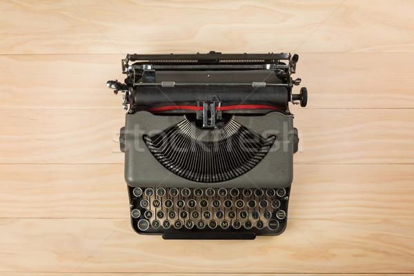 vintage typewriter isolated on wooden background Stock photo © lostation