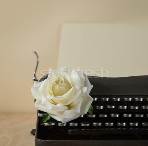 Image of vintage typewriter with white rose Stock photo © lostation