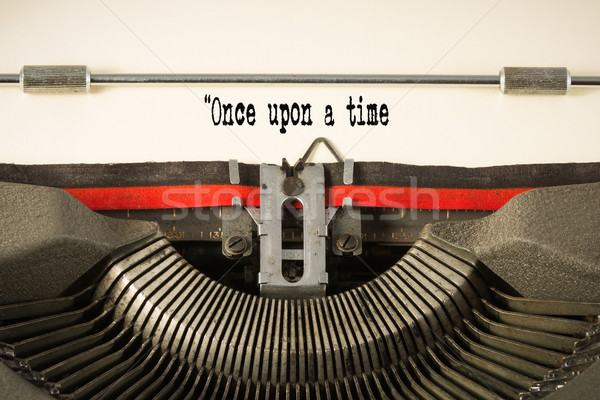 'once upon a time' phase on paper in vintage typewriter Stock photo © lostation