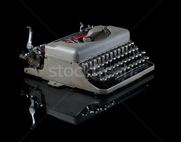 Vintage typewriter isolated on black background Stock photo © lostation