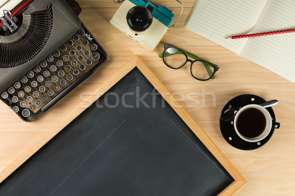 Top view of old typewriter, camera, notebook, glasses, cofee and Stock photo © lostation