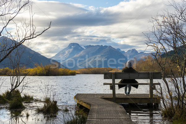 woman sits by Glenorchy lagoon Stock photo © lostation