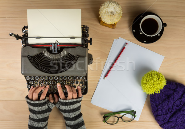 vintage typewriter with work stuff and hands overhead Stock photo © lostation