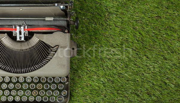 Stock photo: vintage typewriter isolated on grass background