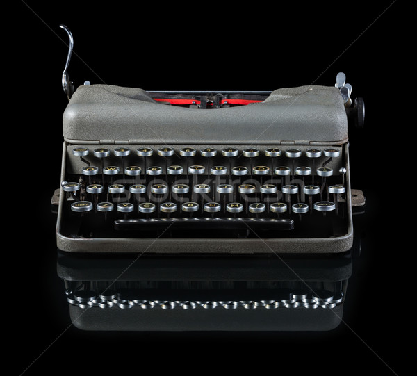 Vintage typewriter isolated on black background Stock photo © lostation