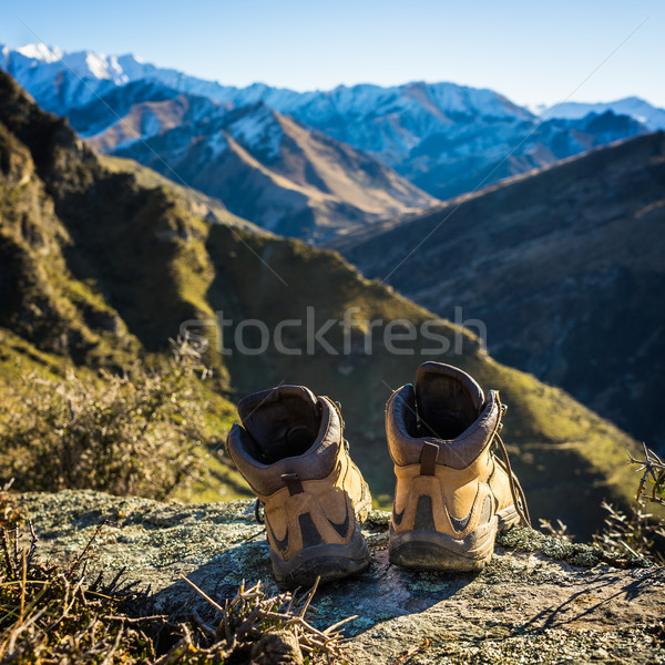 hiking boots lying on top of the mountain Stock photo © lostation