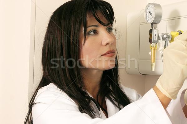 Doctor using medical equipment Stock photo © lovleah