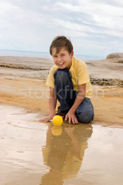 Child playing in water rockpool Stock photo © lovleah
