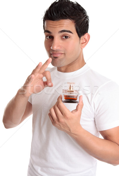 Man recommending promoting a perfume Stock photo © lovleah