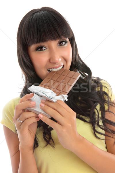 Beautiful girl eating a block of chocolate Stock photo © lovleah