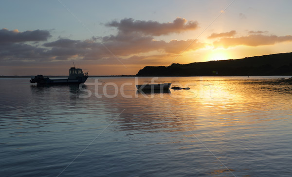 Boats on the water at sunrise Stock photo © lovleah
