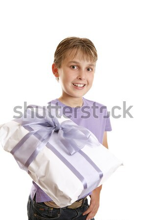 A boy holding a wrapped present Stock photo © lovleah