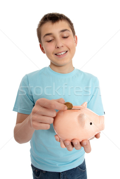 Boy dropping coin into money box Stock photo © lovleah