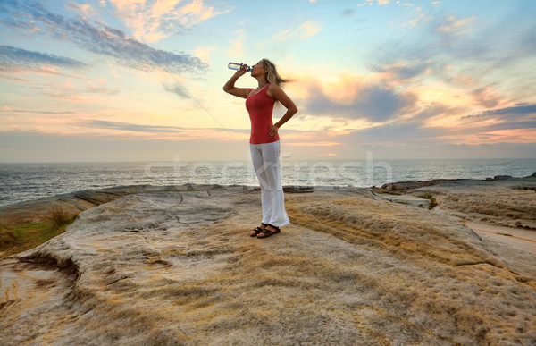 Woman drinking bottled water outdoors Stock photo © lovleah