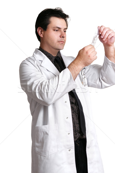 Doctor with saline solution Stock photo © lovleah