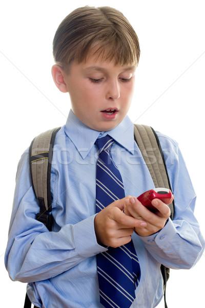 Iskolás fiú gyermek sms sms chat iskolás fiú diák Stock fotó © lovleah