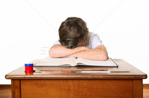 School child with head down in arms Stock photo © lovleah