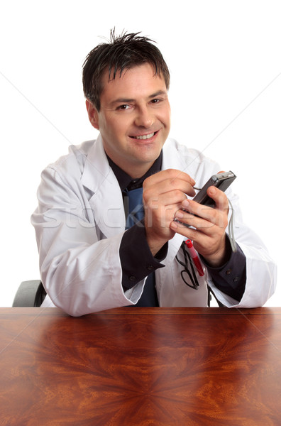 Doctor using an electronic PDA Stock photo © lovleah