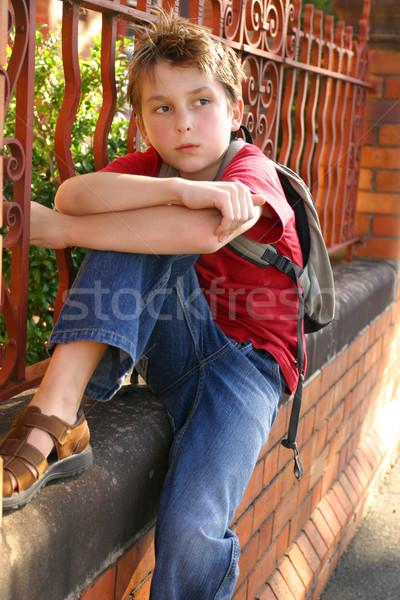 Boy with schoolbag slung over shoulder Stock photo © lovleah