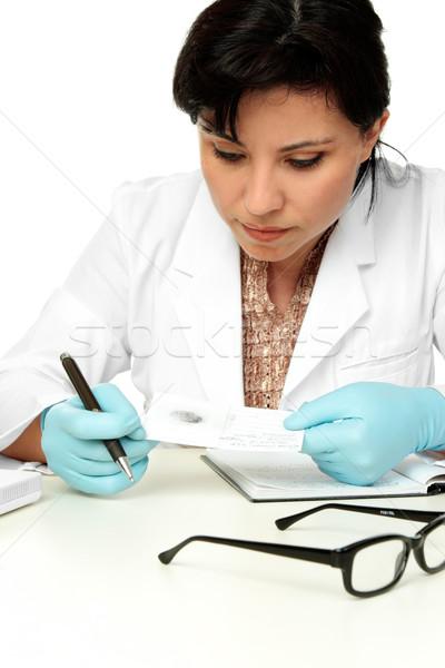 Tudós tart ujjlenyomat minta női törvényszéki Stock fotó © lovleah