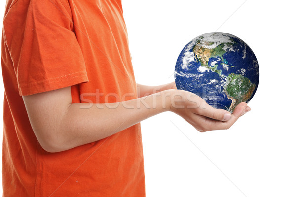 Stock photo: Hands cupping holding our planet Earth