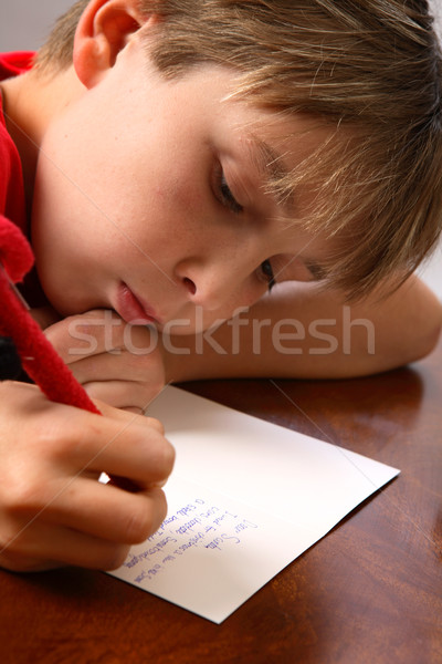 Boy writing note letter to santa Stock photo © lovleah