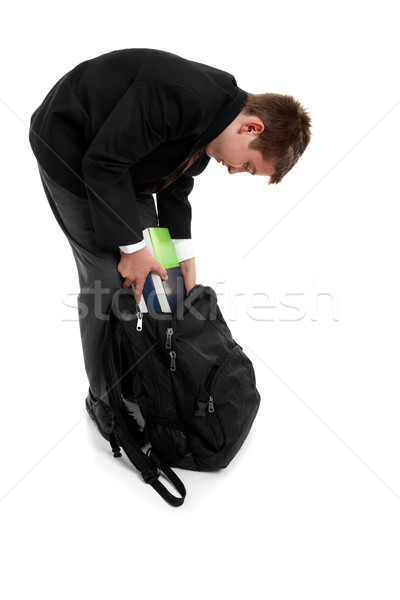 School boy packing school bag Stock photo © lovleah