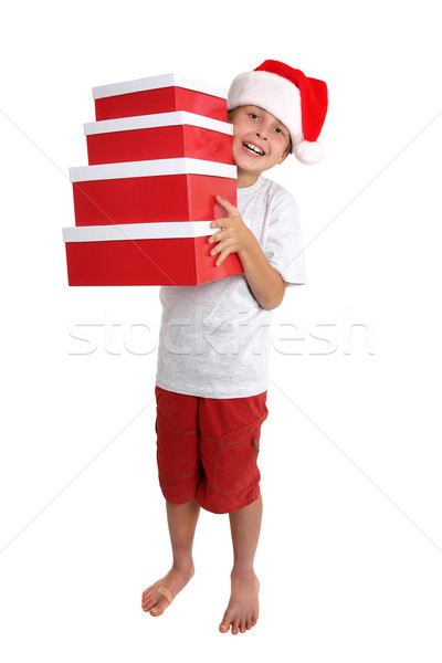 Child holding a stack of gift boxes Stock photo © lovleah