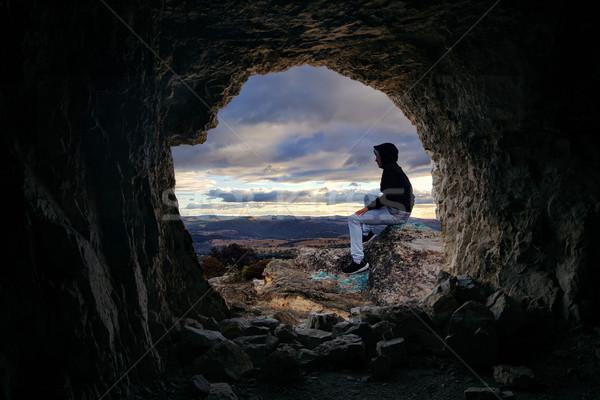 Mağara vadi bakıyor erkek oturma Stok fotoğraf © lovleah