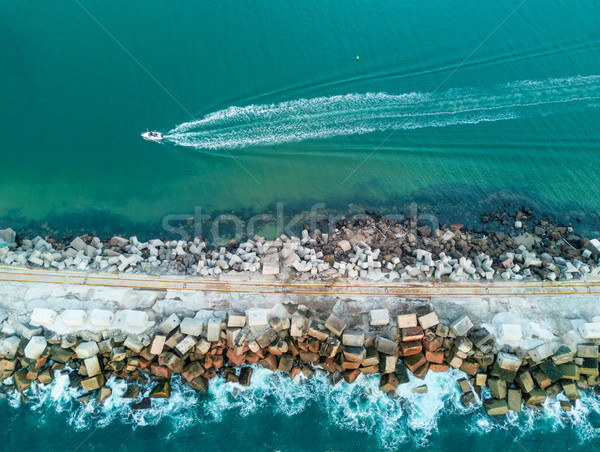 A speed boat and a breakwall aerial view Stock photo © lovleah