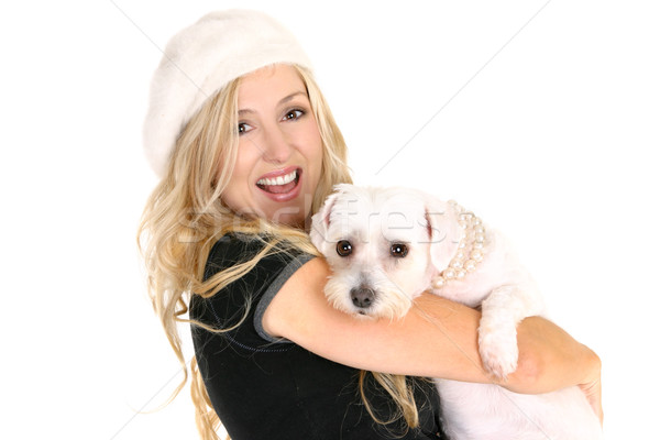 Smiling female holding a dog in her arms Stock photo © lovleah